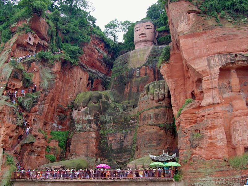 the-232-foot-high-leshan-giant-buddha-carved-on-the-hillside-of-the-xijuo-peak-overlooks-three-of-chinas-rivers-the-unesco-world-heritage-site-is-built-with-incredible-detail-over-a-thousand-buns-were-mad