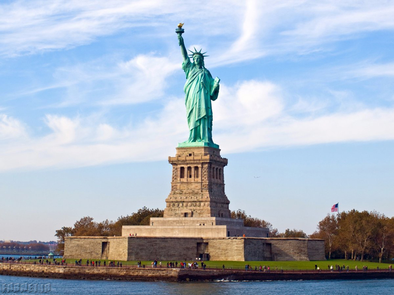 the-statue-of-liberty-stands-high-and-mighty-in-new-york-harbors-liberty-island-the-1510-foot-statue-was-created-in-france-with-giant-steel-supports-before-being-assembled-in-america