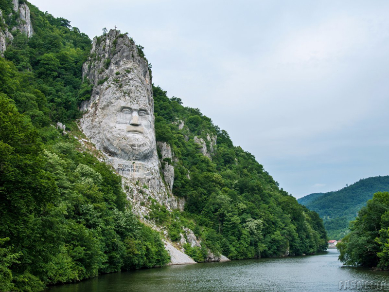 this-rock-sculpture-of-the-face-of-decebalus-dacias-last-king-is-carved-on-a-jagged-outcrop-of-the-danube-river-near-the-city-of-orsova-in-romania-the-131-foot-high-carving-is-the-tallest-rock-sculpture-i