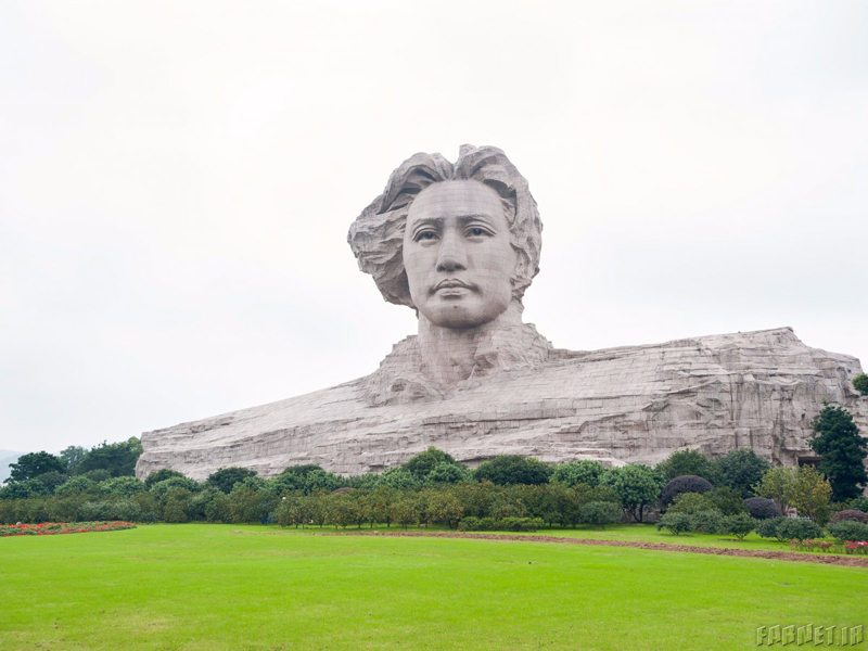 this-statue-perched-in-chinas-hunan-province-depicts-chairman-mao-zedong-at-the-age-of-32-the-work-is-said-to-have-cost-as-much-as-35-million-to-build
